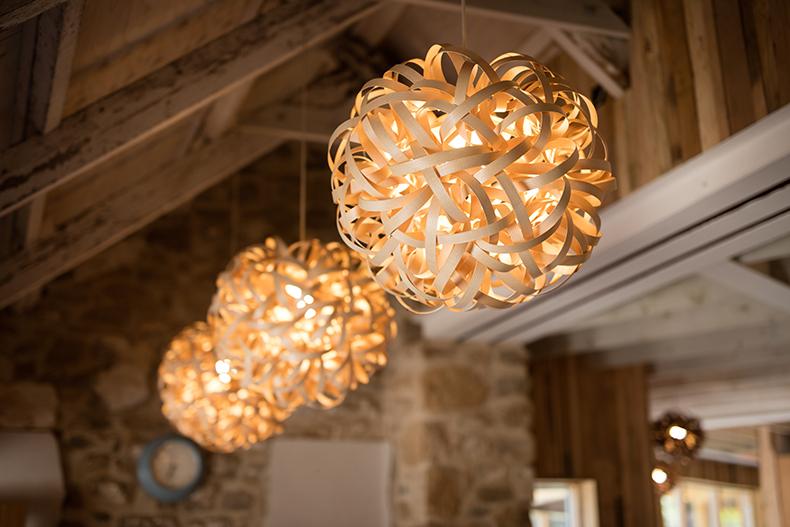 Group of three Tom Raffield pendant lights