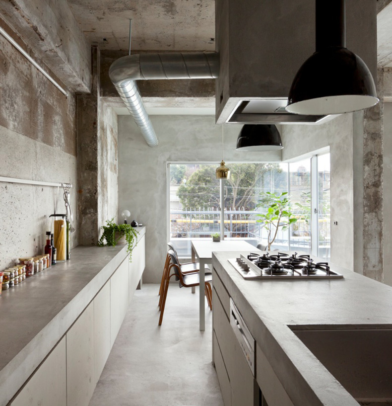 Concrete Apartment black enamel pendants in kitchen
