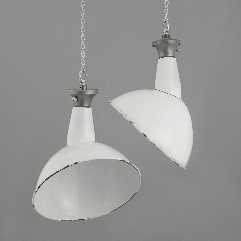 Angled white enamel pendant lights by Benjamin