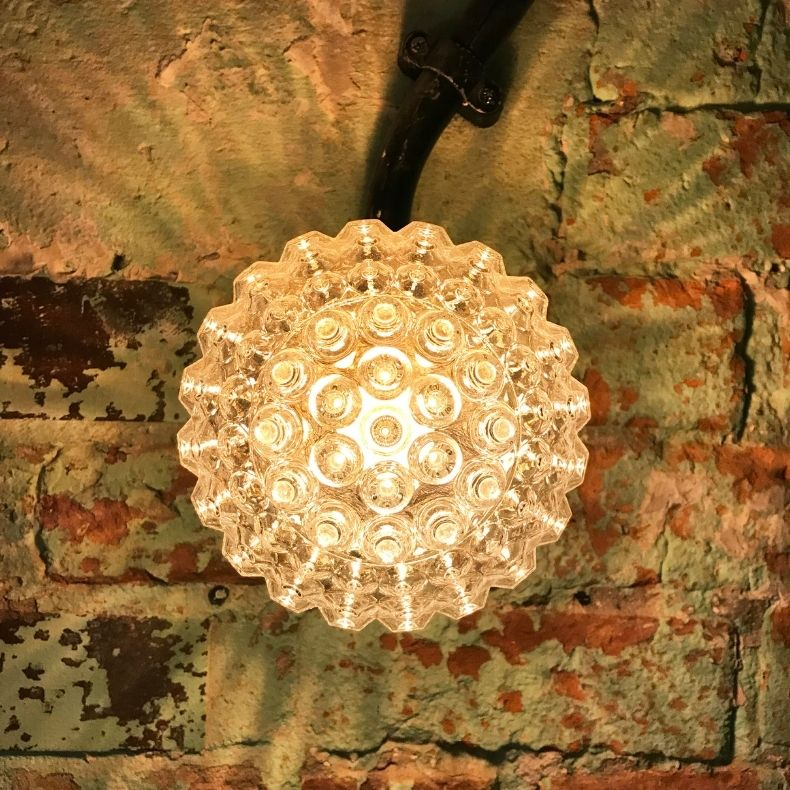 Retro Czech wall lights in the intimate dining area at Tre Ciccio